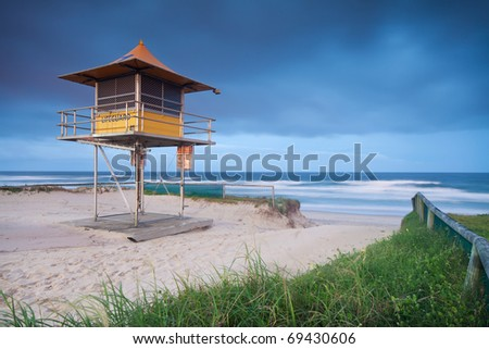 lifeguard hut on australian beach with interesting clouds in background - stock photo