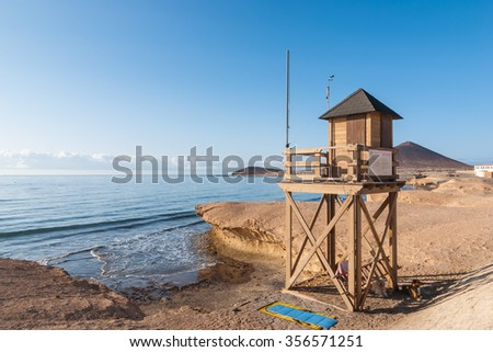 Lifeguard lookout post on the shore of Medano, Tenerife, Spain - stock photo