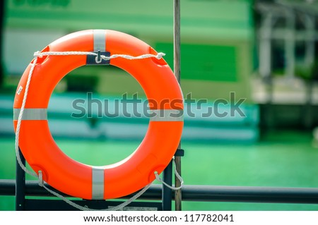 Lifeguard on a boat with blurry background - stock photo