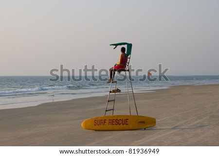 Lifeguard overlooking tropical beach, Goa India - stock photo