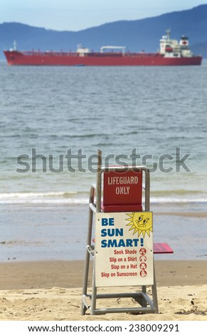 Lifeguard seat at Stanley Park with oil tanker. Vancouver. Canada - stock photo