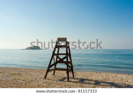 Lifeguard seat on an idyllic Mediterranean beach - stock photo