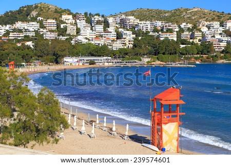 Lifeguard shelter on a sandy beach near the shores of Aegean sea, Vouliagmeni, Greece - stock photo