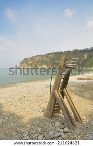 Lifeguard stand, in a desert beach. - stock photo