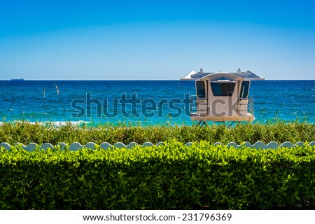 Lifeguard station and the Atlantic Ocean in Palm Beach, Florida. - stock photo
