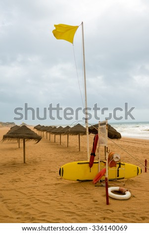Lifeguard station on a deserted beach during a gray autumn day - stock photo