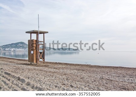 Lifeguard station on empty beach on a sunny winter morning in December in Ibiza, Balearic islands, Spain - stock photo
