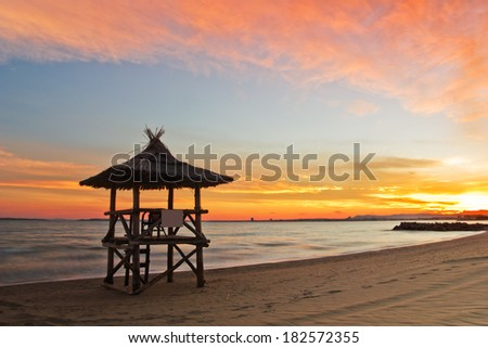 Lifeguard station on the beach at sunset  - stock photo