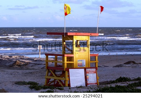 lifeguard station or stand on the beach as the sun is setting - stock photo