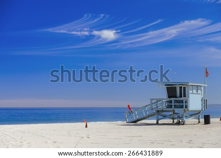 Lifeguard station with american flag on Hermosa beach, instagram toning, California, USA  - stock photo