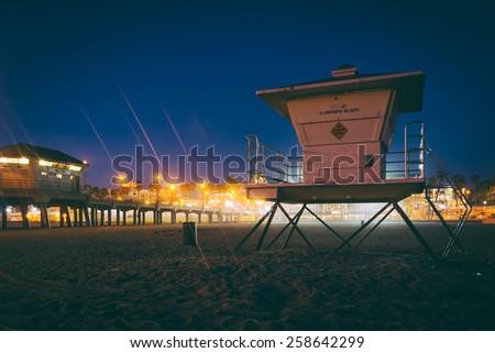 Lifeguard tower at night, in Huntington Beach, California. - stock photo