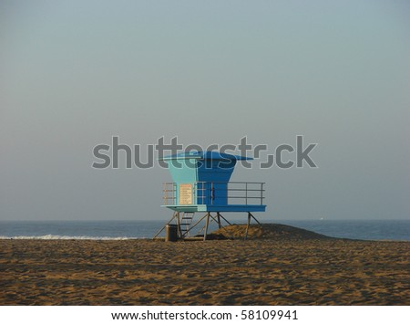 lifeguard tower on beach with ocean in background - stock photo
