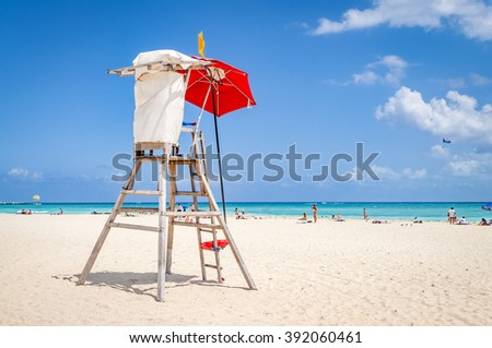 lifeguard tower protecting the safety of tourist on the beach at Playa del Carmen, Mexico - stock photo