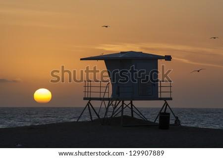 lifeguard tower sunset - stock photo