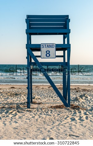 Lifeguard tower. The number eight. Beach lifeguard station. Beach and ocean. Ocean background. Sea background. Waves background. Beach life. Blue ladder. Blue tower. Minimal design. Abstract art. - stock photo