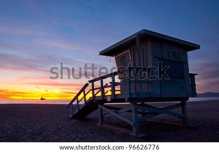 Lifeguard tower under a beautiful sunset - El Segundo Beach, Los Angeles, California. - stock photo