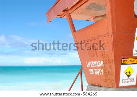 Lifeguard tower with lifeguard's arm showing - stock photo