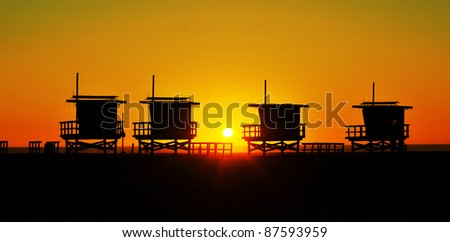 Lifeguard towers in Venice Beach, United States, at sunset - stock photo