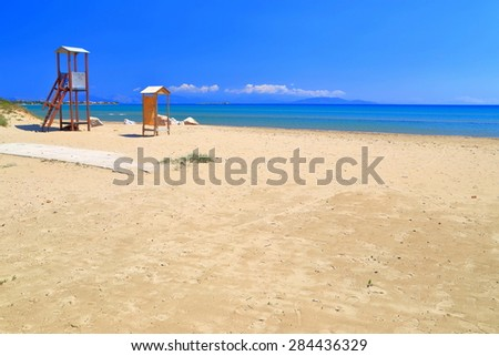 Lifeguard towers on sunny beach near the shores of Aegean sea, Greece - stock photo
