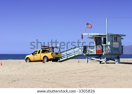 Lifeguard Vehicle And Tower On Los Angeles Beach - stock photo
