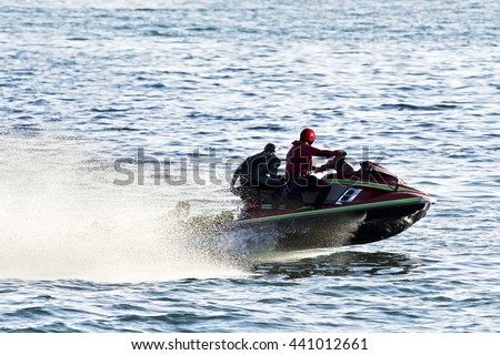 lifeguards in jet ski in  rescue training - stock photo