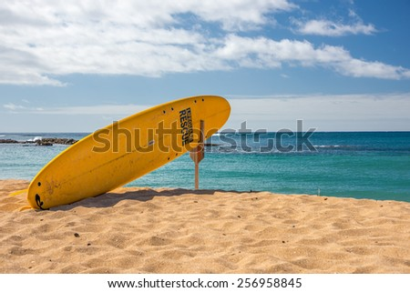 Lifeguards rescue surfboard on stand at a beach on Kauai, Hawaii