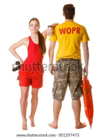 Lifeguards with binoculars and rescue buoy tube. Man and woman supervising swimming pool. Accident prevention. - stock photo