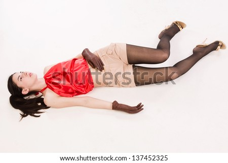 Lifeless brunette in red lying on the floor