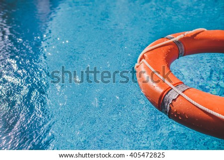 Lifesaver (Life Buoy) belt in water. A life preserver in open blue water.