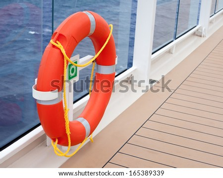 Lifesaver Ring on the deck of a cruise ship - stock photo
