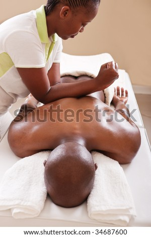lifestyle, African American man having a massage treat at the spa, or injury chiropractor - stock photo