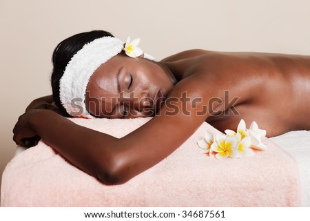 lifestyle, african american woman having a massage treat at the spa