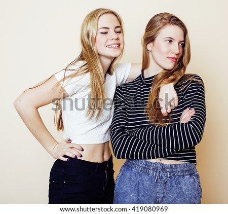 lifestyle and people concept: Fashion portrait of two stylish sexy girls best friends, over white background. Happy time for fun.
