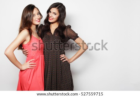 lifestyle and people concept: Two young girl friends standing to