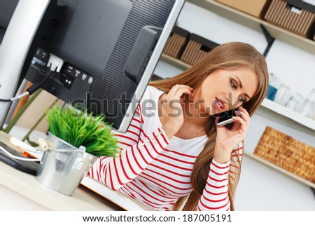 Lifestyle. Attractive woman at work in the office