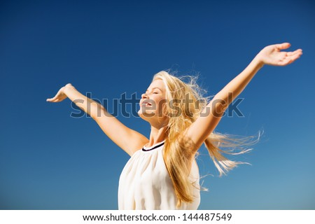 lifestyle concept - beautiful happy woman enjoying summer outdoors - stock photo