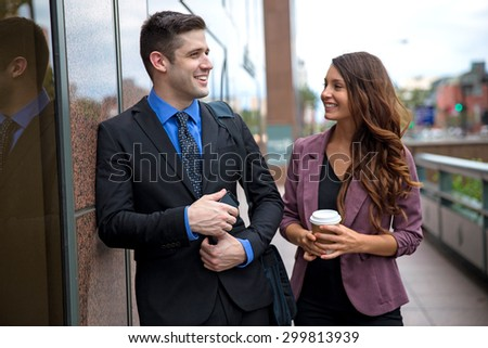 Lifestyle coworkers communicating together on a work break socializing attractive single professionals love laughter - stock photo