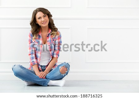 Lifestyle. Cute, attractive woman on the floor