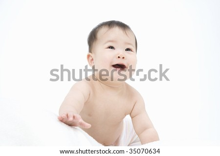 LIFESTYLE IMAGE-a lovely smiling baby isolated on white