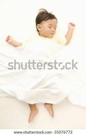 LIFESTYLE IMAGE-a sleeping baby isolated on white - stock photo