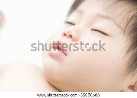 LIFESTYLE IMAGE-close-up shot of sleeping baby's face - stock photo