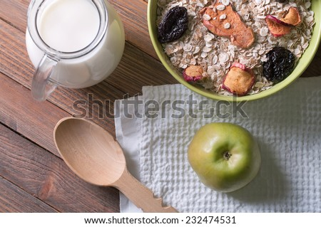 Lifestyle photo of healthy breakfast with oat-flakes and milk - stock photo
