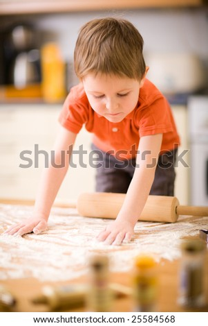 Lifestyle picture of little boy baking cookies. - stock photo