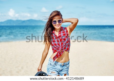 Lifestyle portrait of cheerful brunette hipster girl having fun outdoor - stock photo