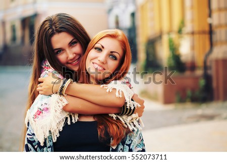 Lifestyle portrait of young traveler best friends girls