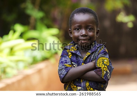 Lifestyle: Proud African Boy Posing with Arms Crossed. In the streets of Bamako, an African boy is posing for the camera. - stock photo