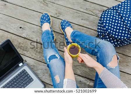 Lifestyle, vacation, education concept. Young hipster girl have a tea time outdoor