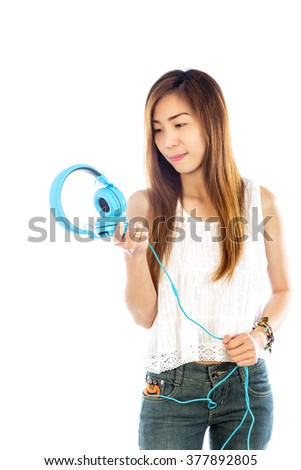 lifestyle Woman listening to music isolated white background