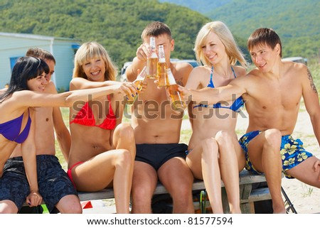 Lifestyle young people on the beach - stock photo