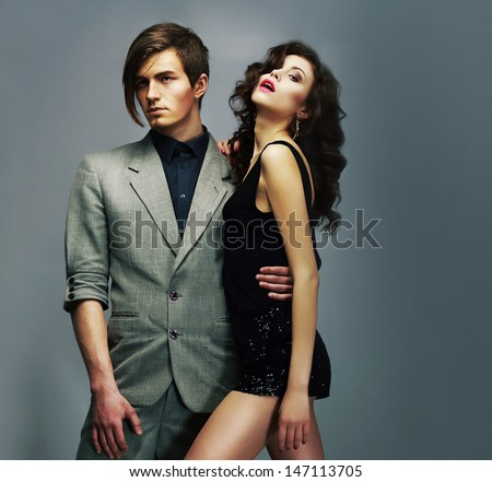 Lifestyle.Young Well-Dressed Couple in Elegant Fashion Clothes Hugging - stock photo